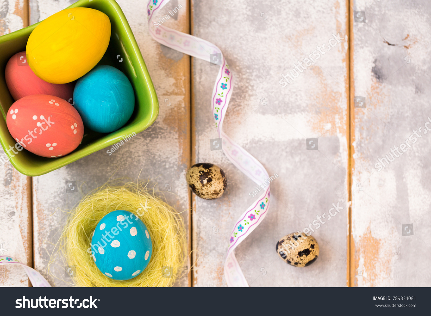 Multicolored Easter Eggs In A Wooden Box And Ribbons On Background Country Style