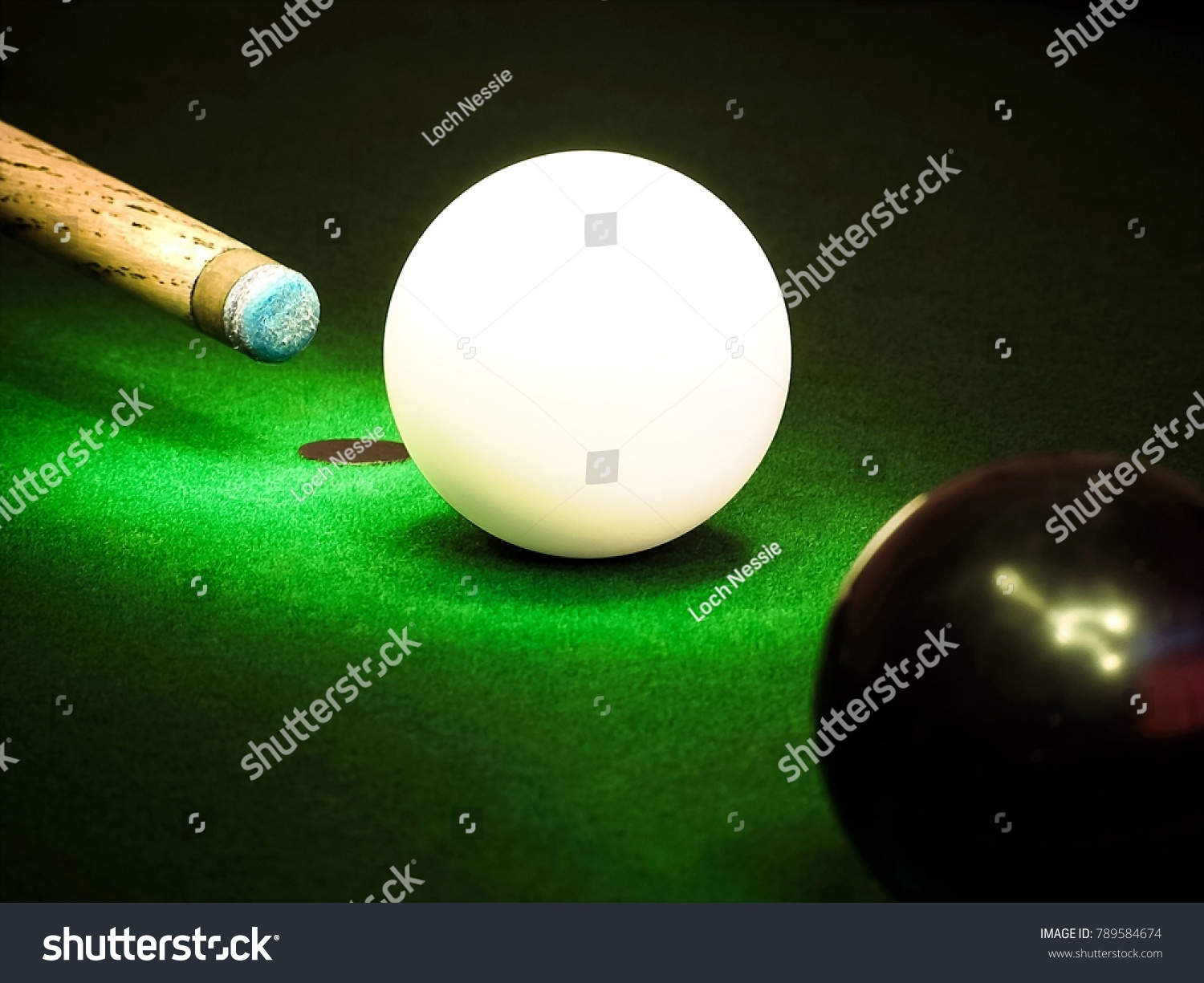stock-photo-cue-aiming-at-the-black-ball