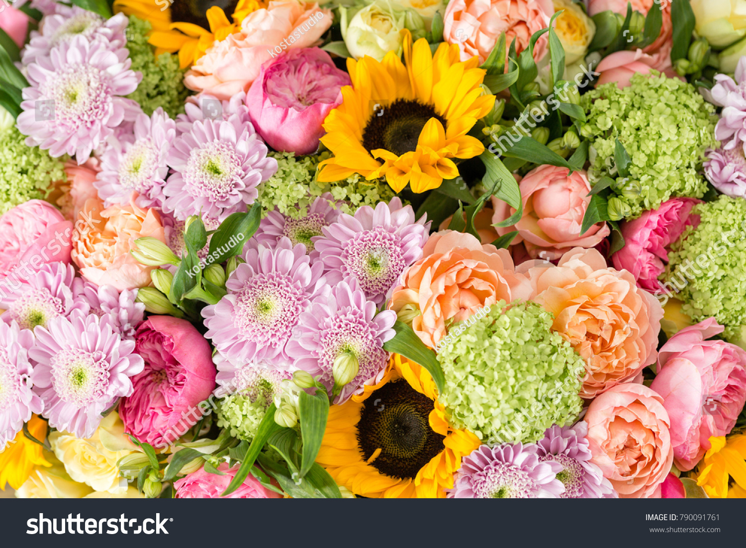 Beautiful bouquet mixed flowers vase on stock photo royalty free beautiful bouquet of mixed flowers in a vase on wooden table the work of the izmirmasajfo