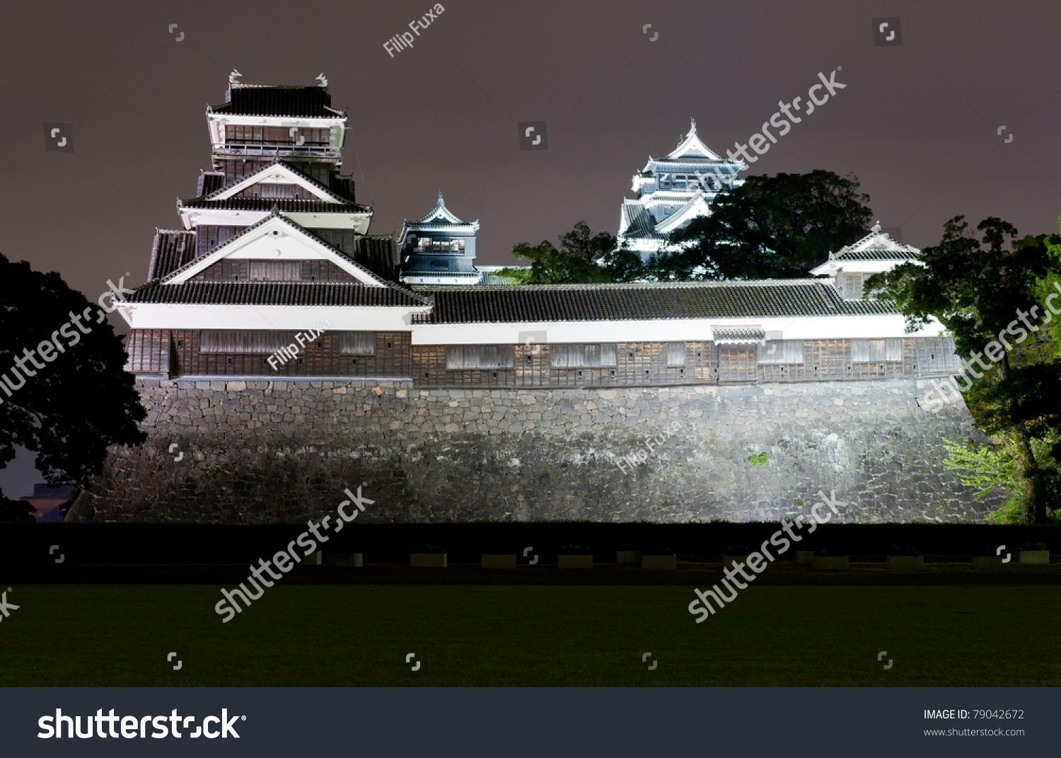 The famous castle in Japanese cisty of Kumamoto is in a fact a reconstruction of the historical building that was destroyed during the WW2. #79042672