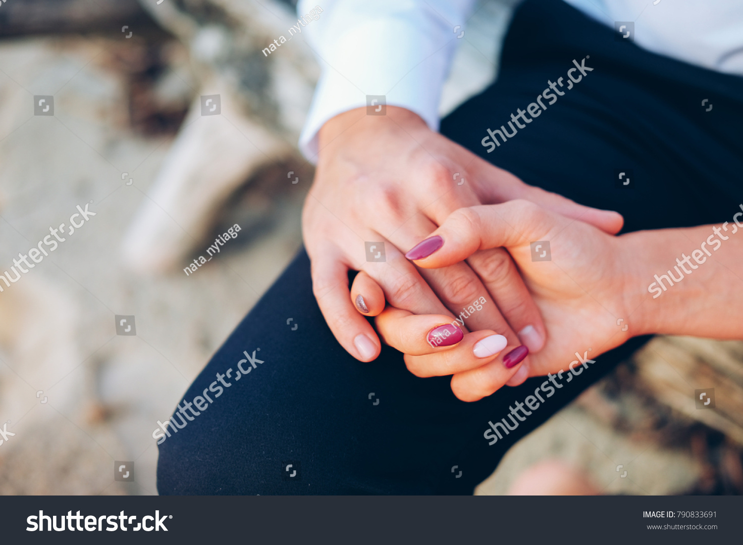 Bridal couple, wemen is wearing wedding rings to finger on left hand ...