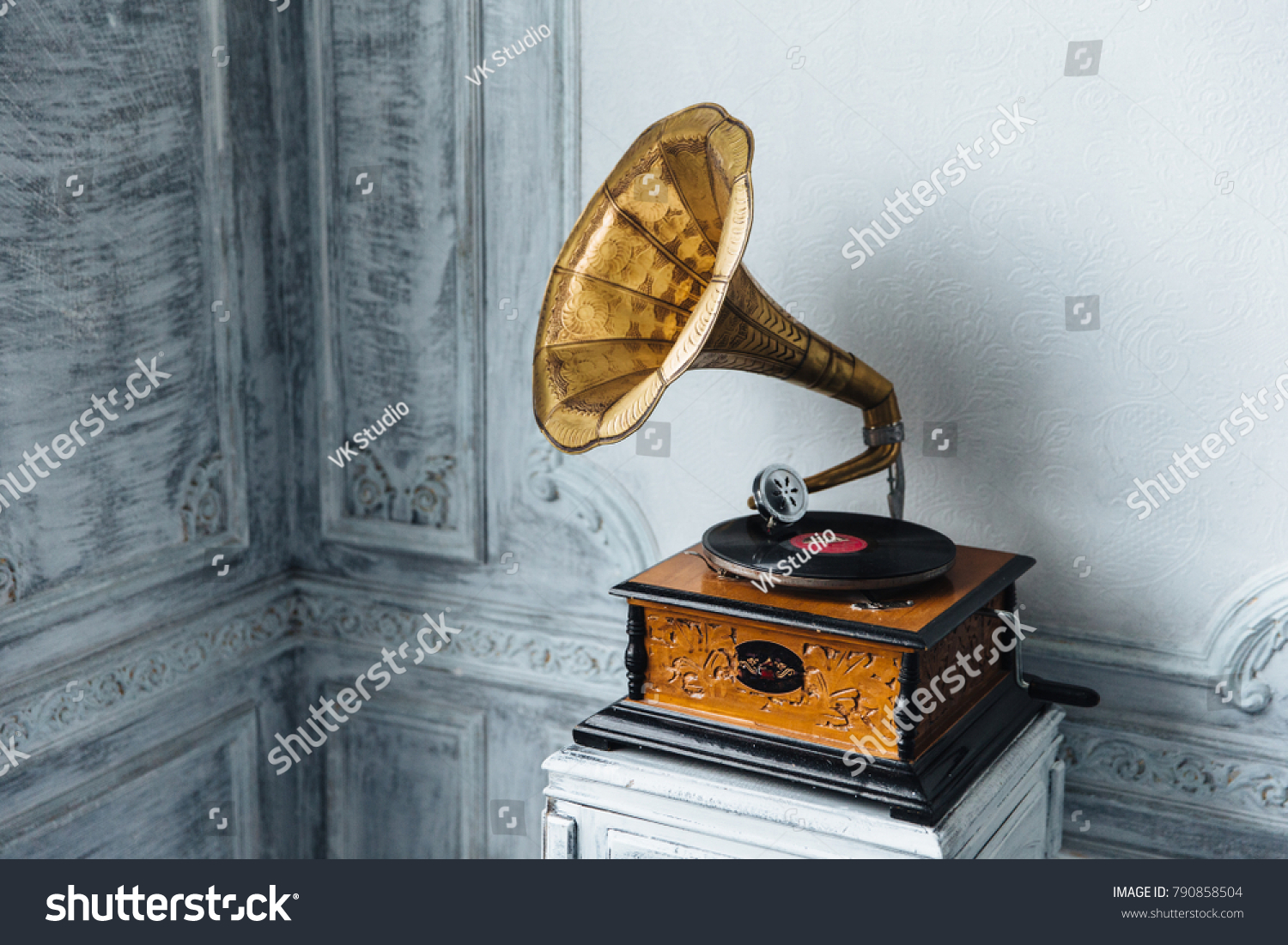 Music device. Old gramophone with plate or vinyl disk on wooden box. Antique brass record player. Gramophone with horn speaker. Retro entertainment concept. #790858504