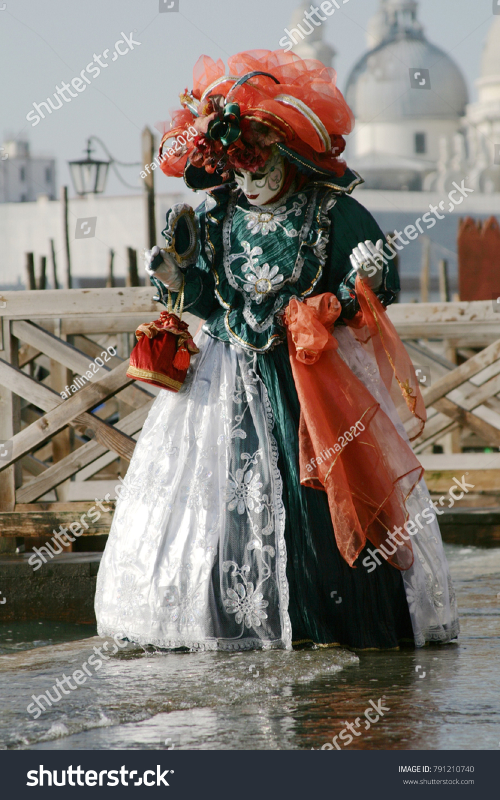 Woman In Beautiful Red Green And White Masquerade Dress Mask At The Venice Carnival Italy