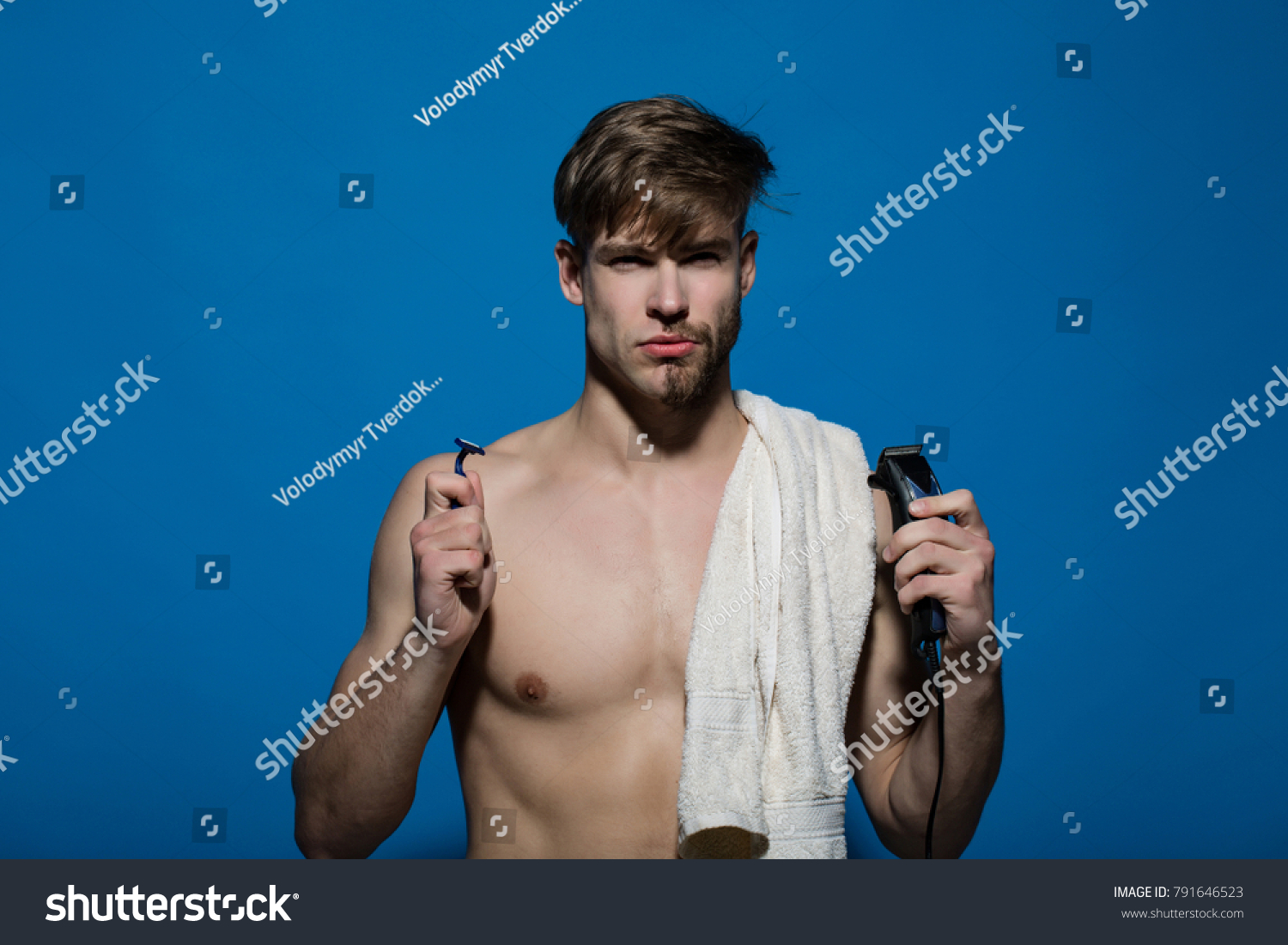 Macho with half bearded face, bath towel on muscular torso. Man choose  safety or