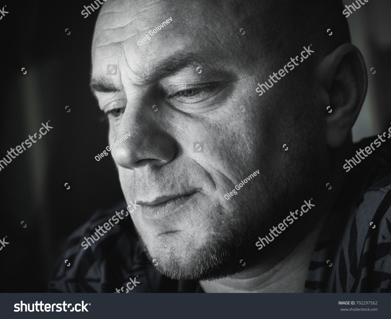 Sad bald man black and white close up portrait