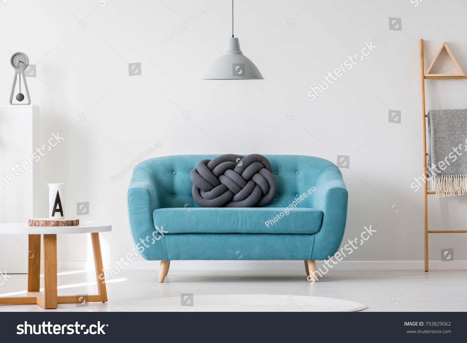Knot Pillow On Turquoise Sofa Living Stock Photo (Download Now ...
