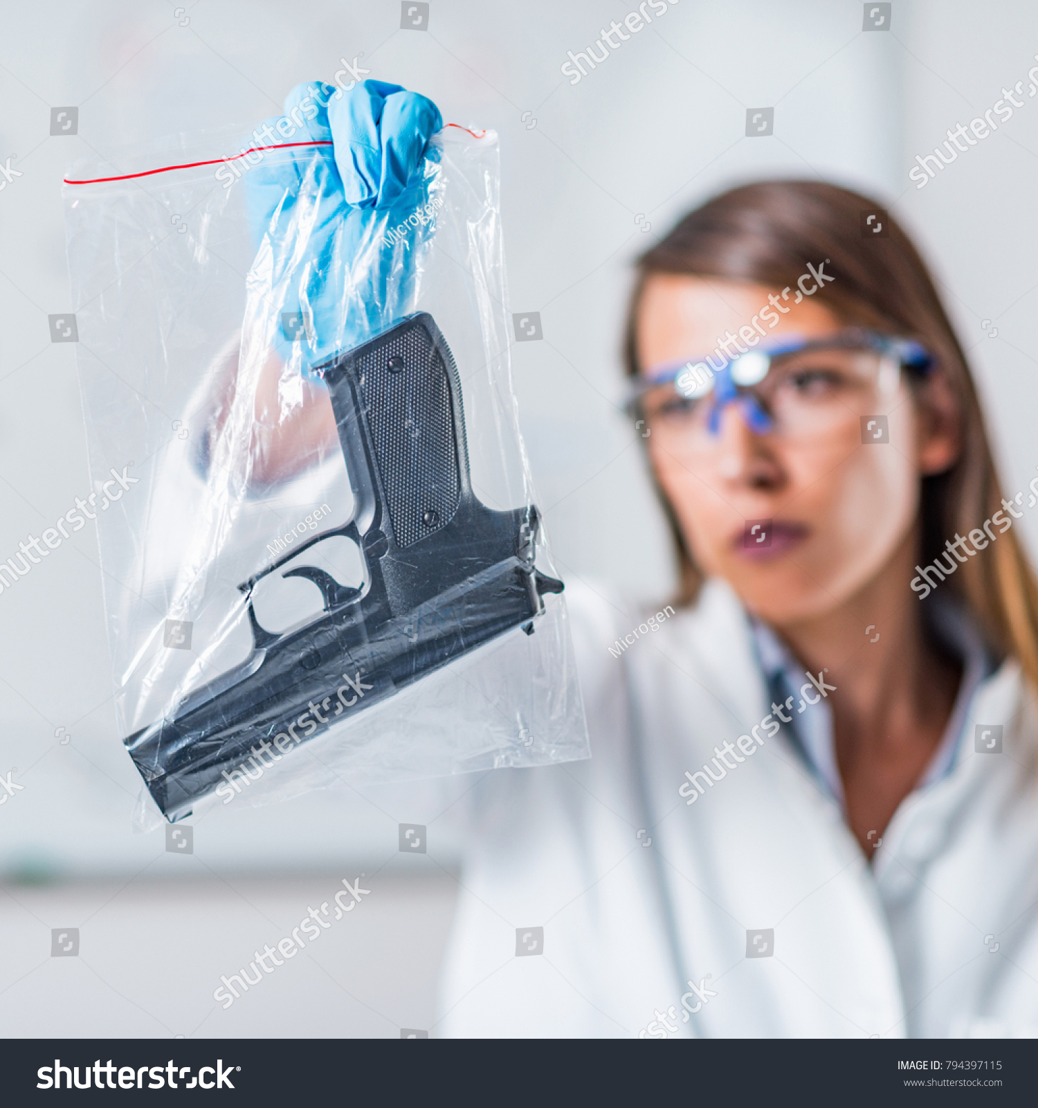 Forensic Science Expert Examining Gun Collected Stock Photo Edit Now 794397115