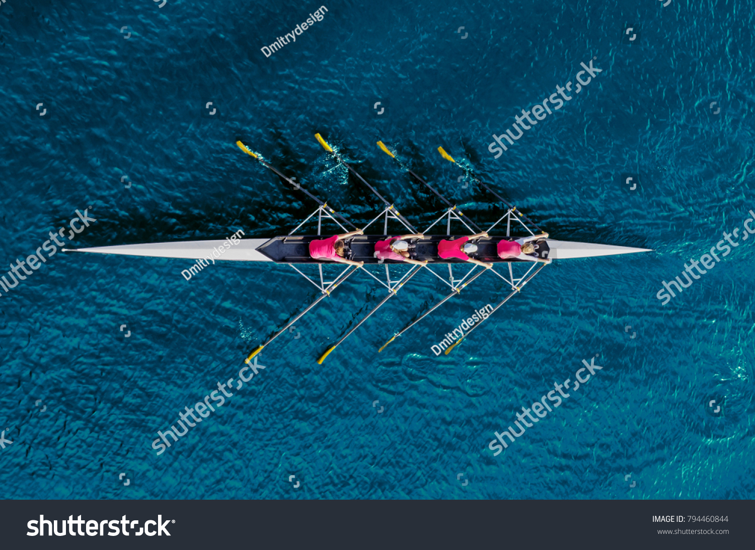 Women's rowing team on blue water, top view #794460844