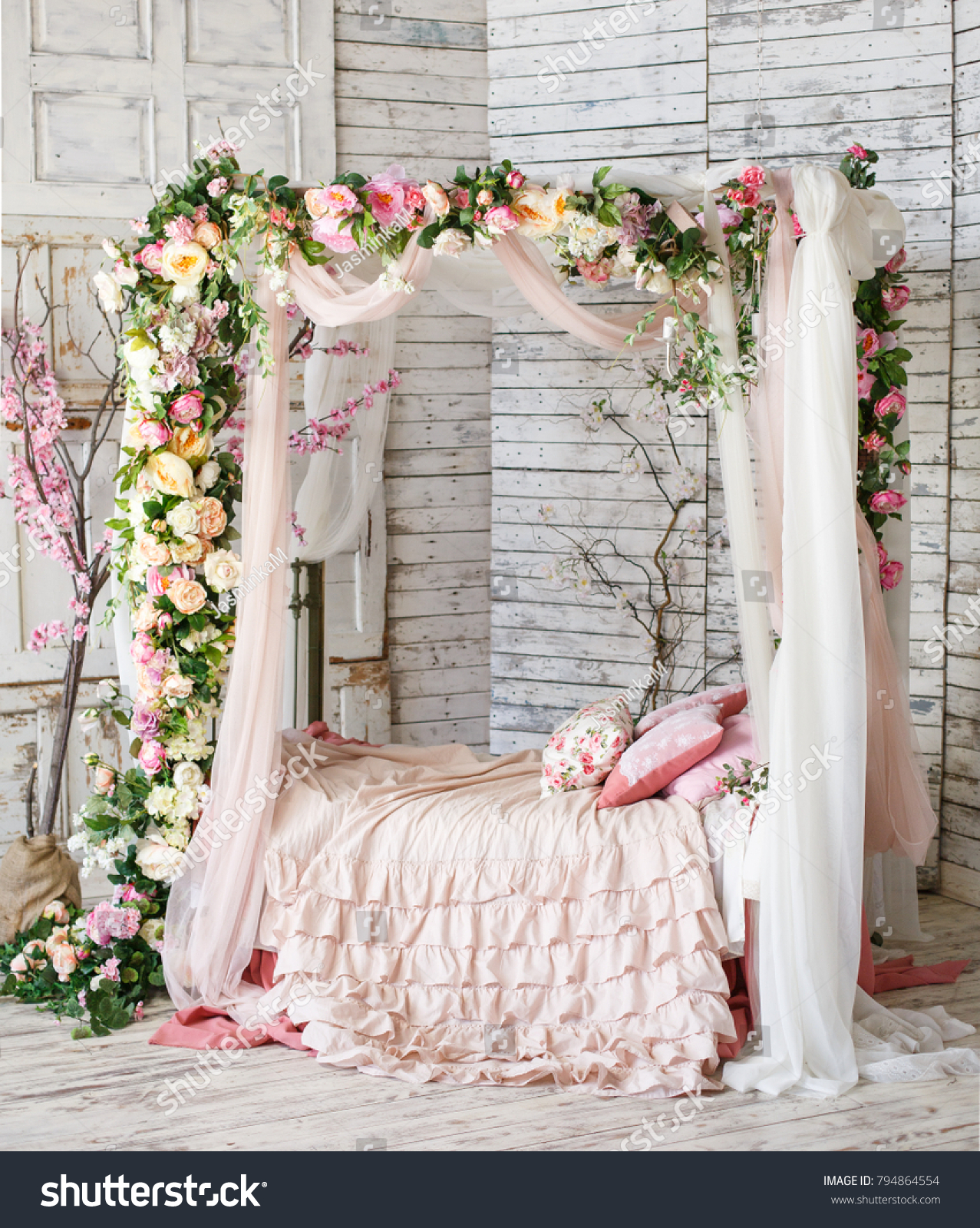 Decorated Bedroom In Natural Style With A Lot Of Flowers. Bed, Braided And  Twined