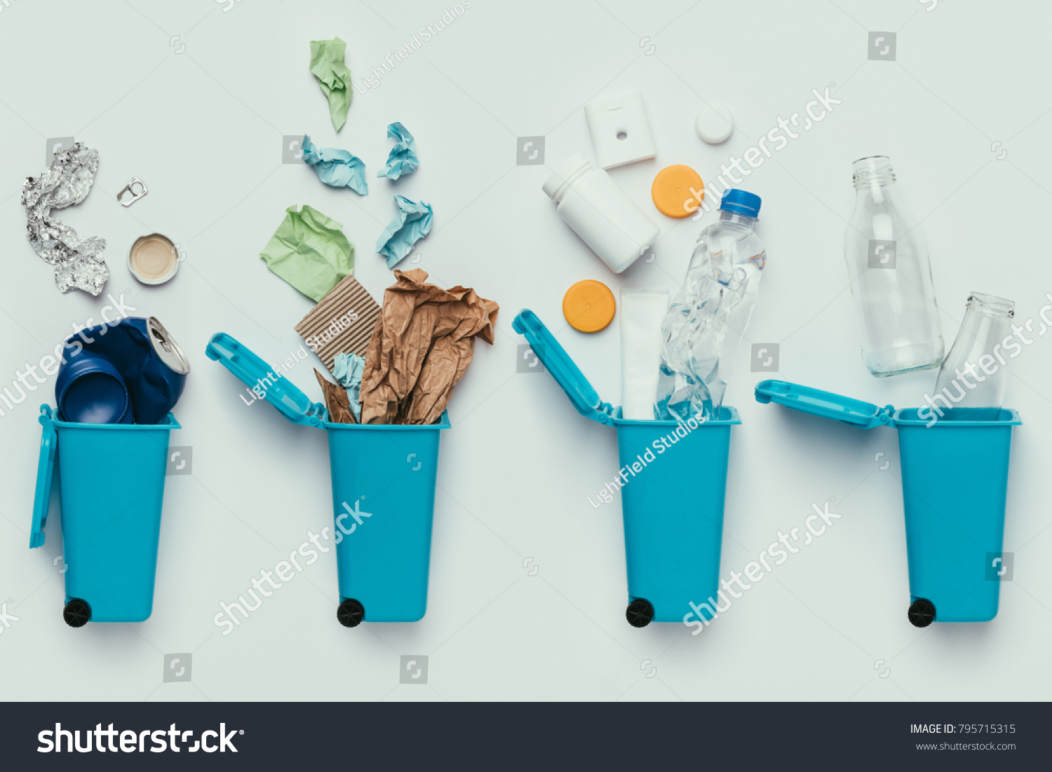 top view of trash bins and assorted garbage isolated on grey, recycle concept #795715315