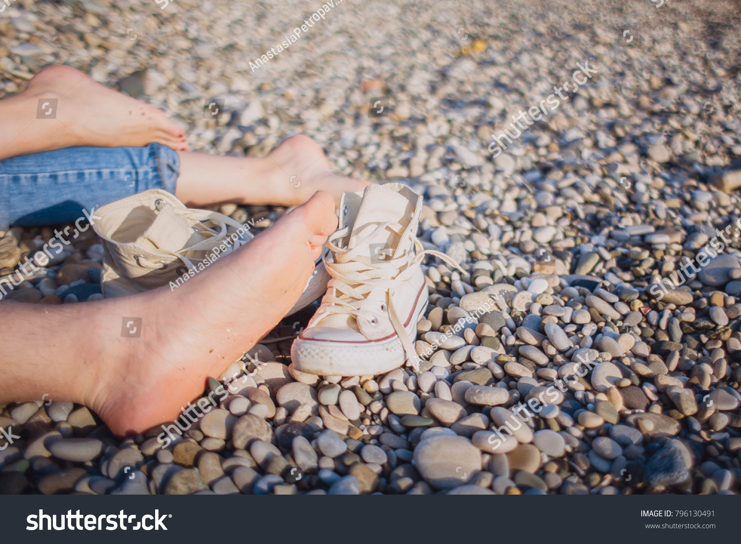 7118f943f02f Bare Feet On Pebble Beach Sneakers Stock Photo (Edit Now) 796130491 ...