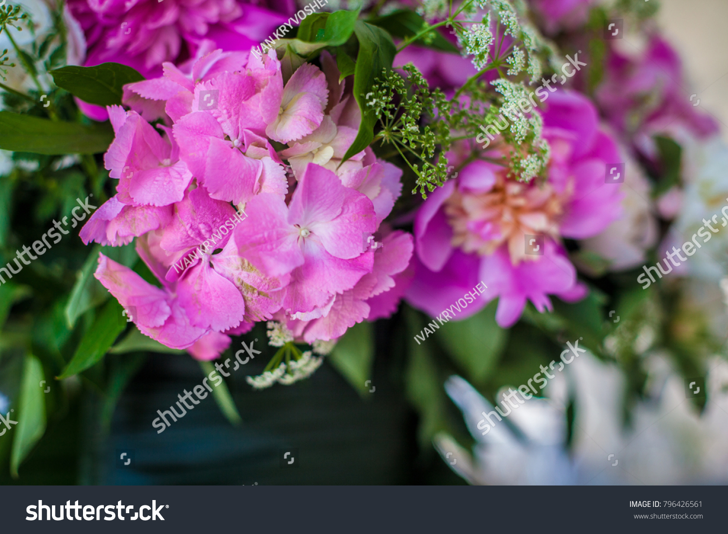 Elegant Flower Decoration On The Table In Restaurant For An Event