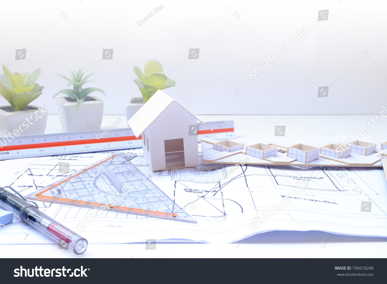Working on process house plan architect stock photo download now working on process house plan architect drawing hand writing background concept house model white background ccuart Gallery