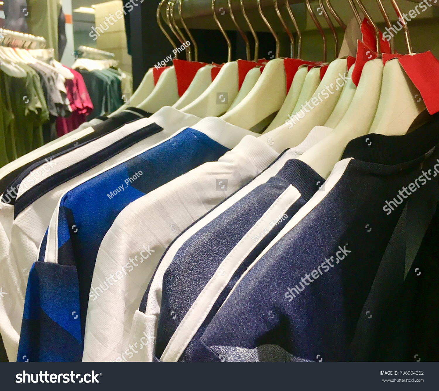 a5091b741cffa Sport t-shirts hanging on hanger in a sport clothing store. Concept be used  for business sport clothing store. Blur picture. - Image