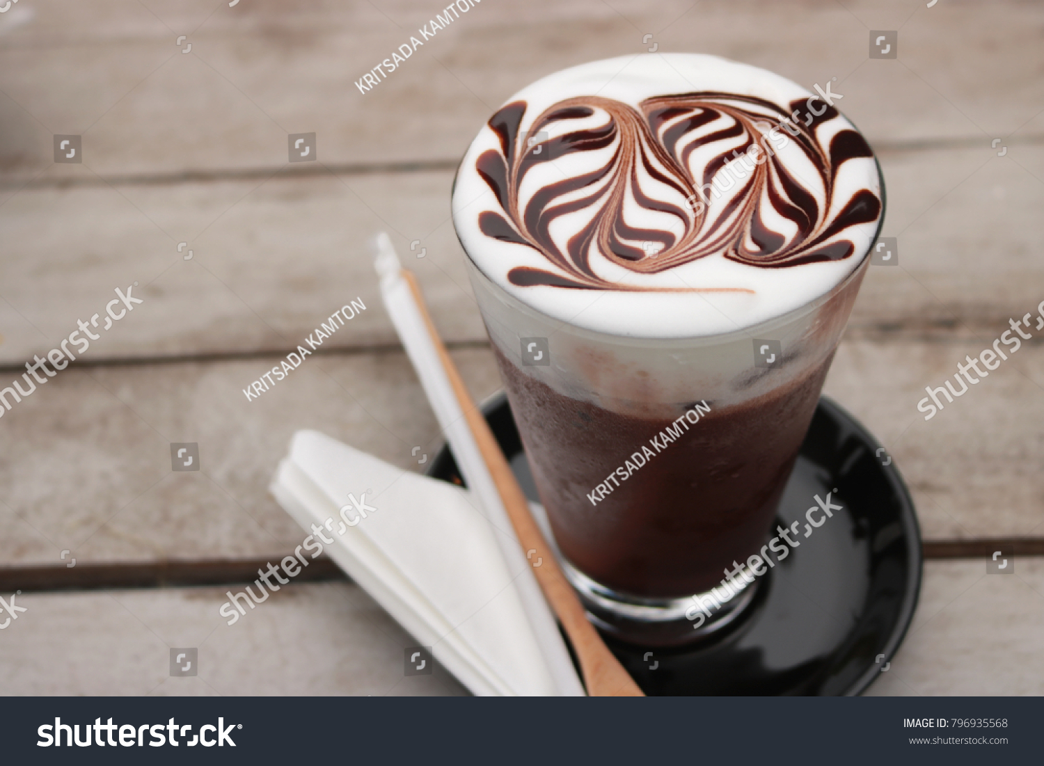 iced mocha coffee. Mocha coffee put in ice in glass. Then make-up beautiful art on top. #796935568