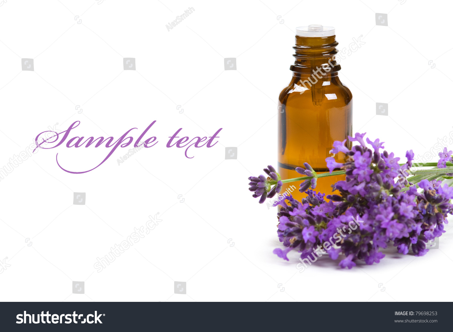 Aromatherapy Oil And Lavender Flowers Isolated On White