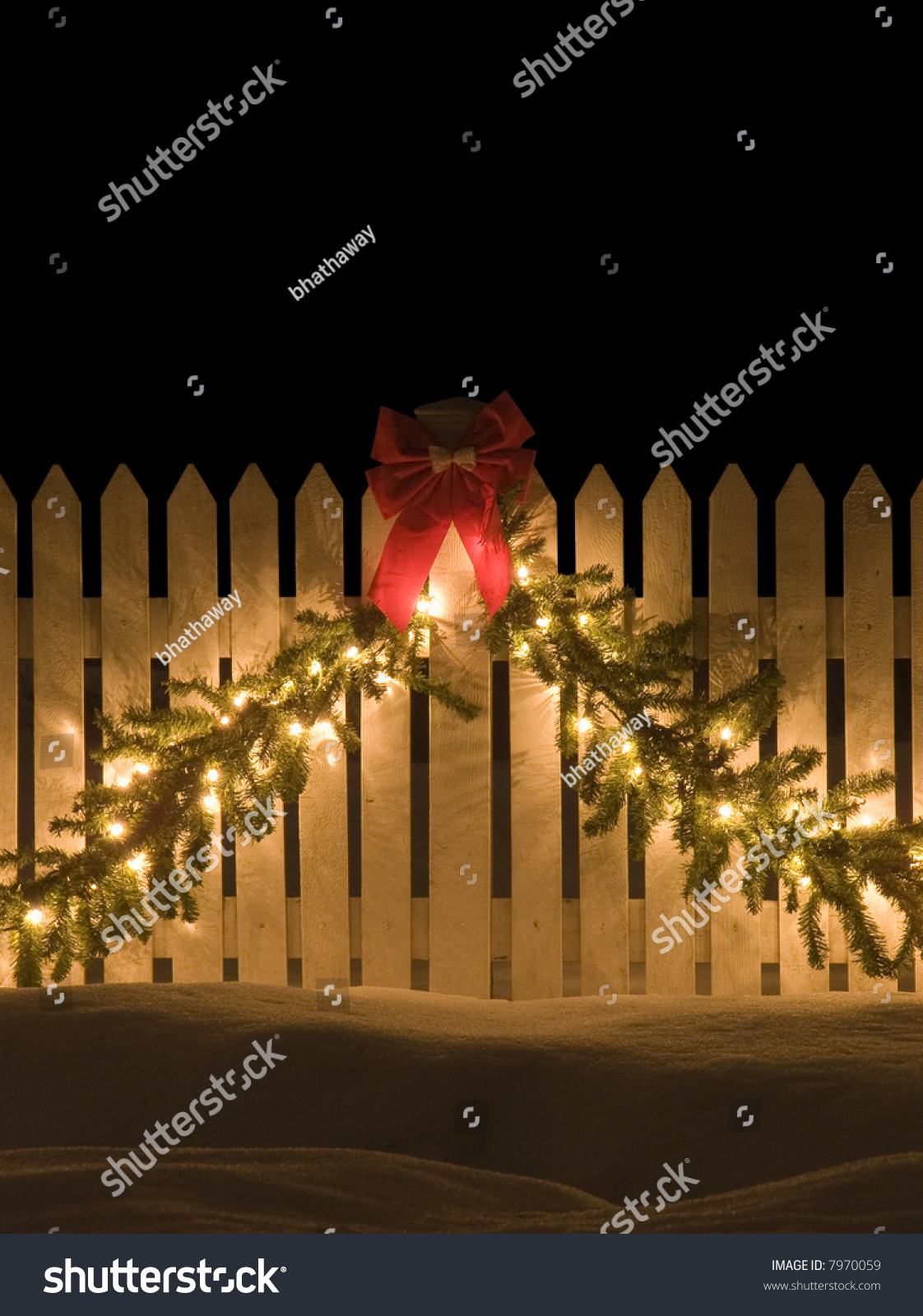 white picket fence with christmas decorations