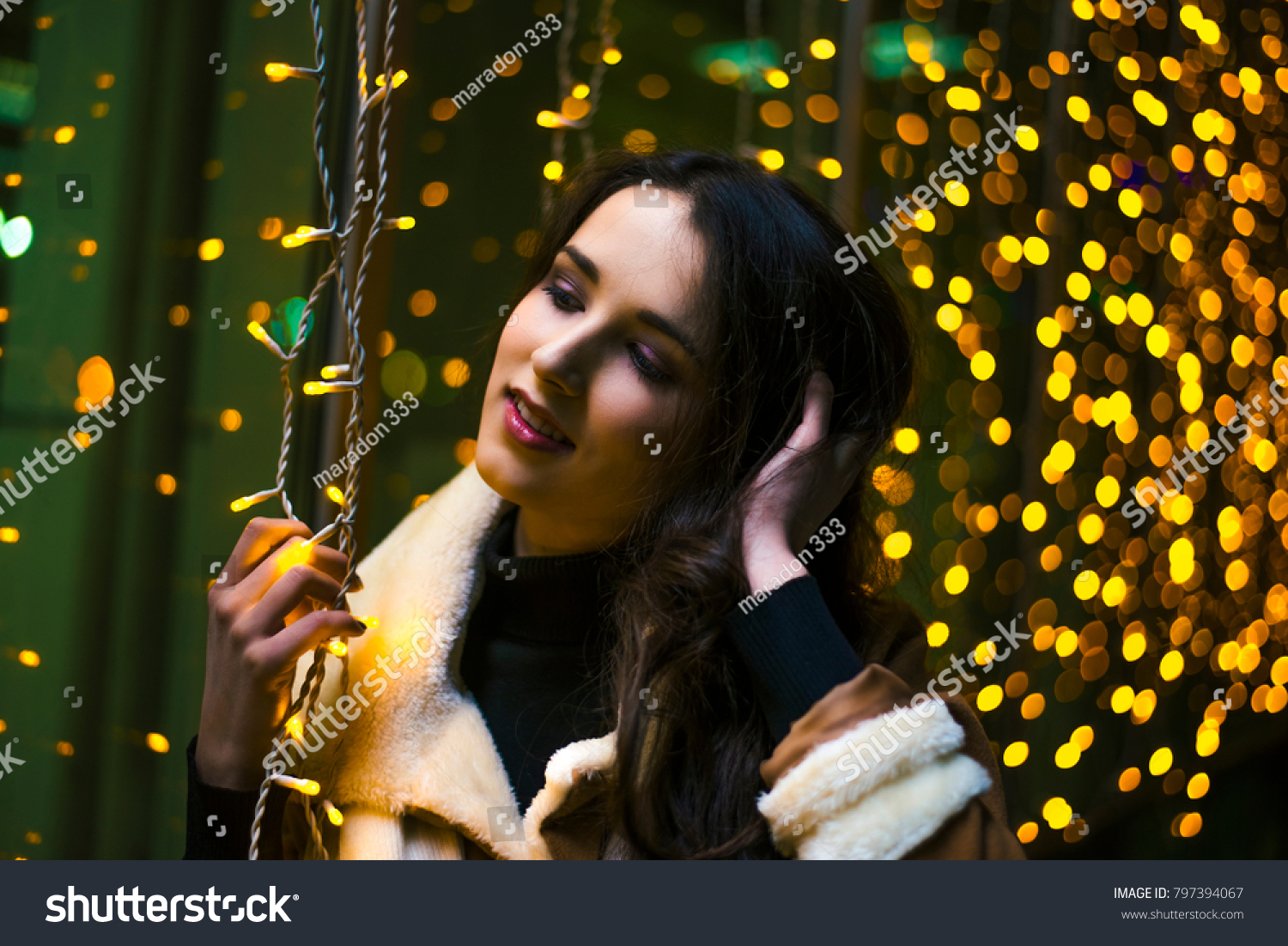 Beautiful asian girl looking dawn on the night city street. background With  bokeh. Copy