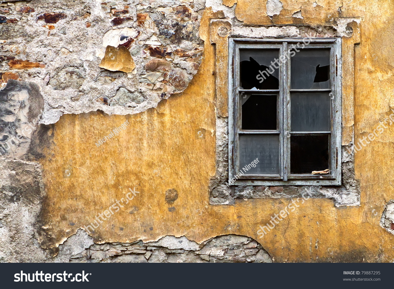 broken window on the yellow  wall