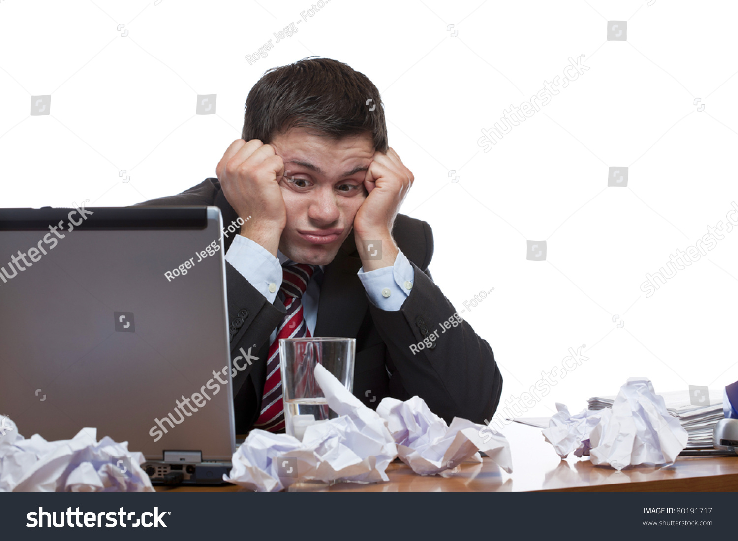 desperate frustrated man sitting paperwork at desk in office save to a lightbox