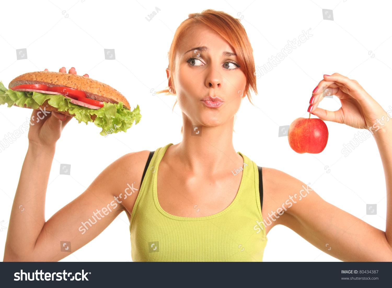 http://image.shutterstock.com/z/stock-photo-slim-woman-choosing-between-apple-and-hamburger-80434387.jpg
