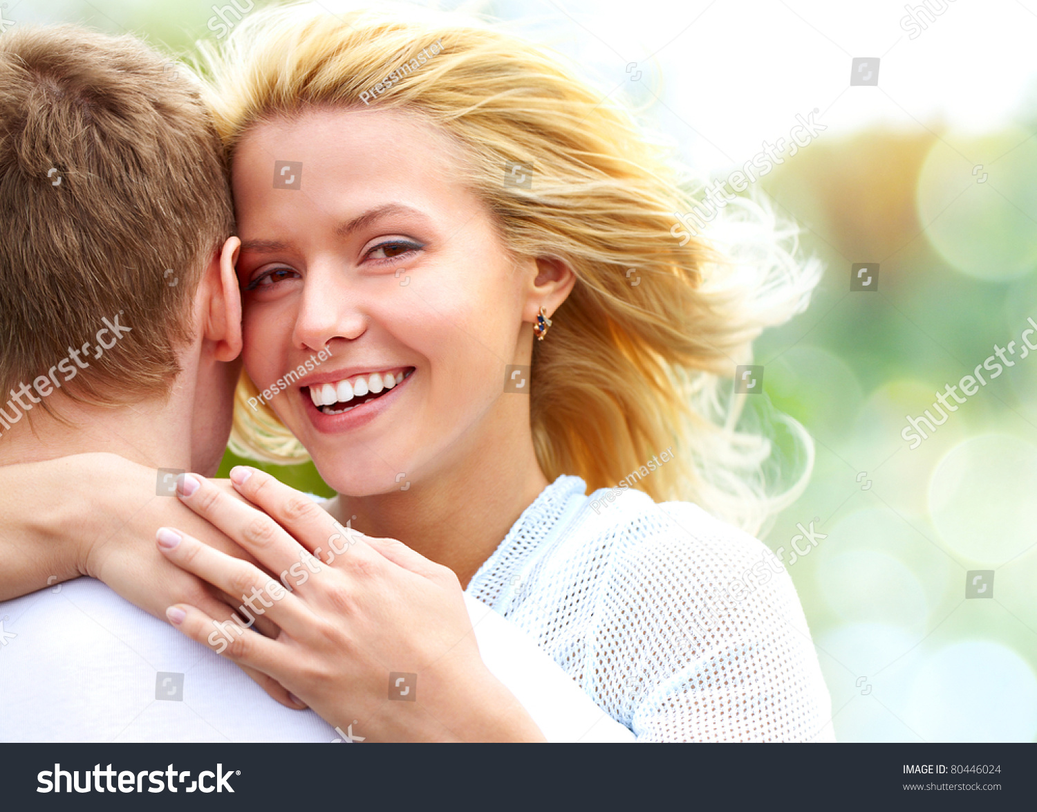 Portrait of happy girl hugging her boyfriend outside #80446024