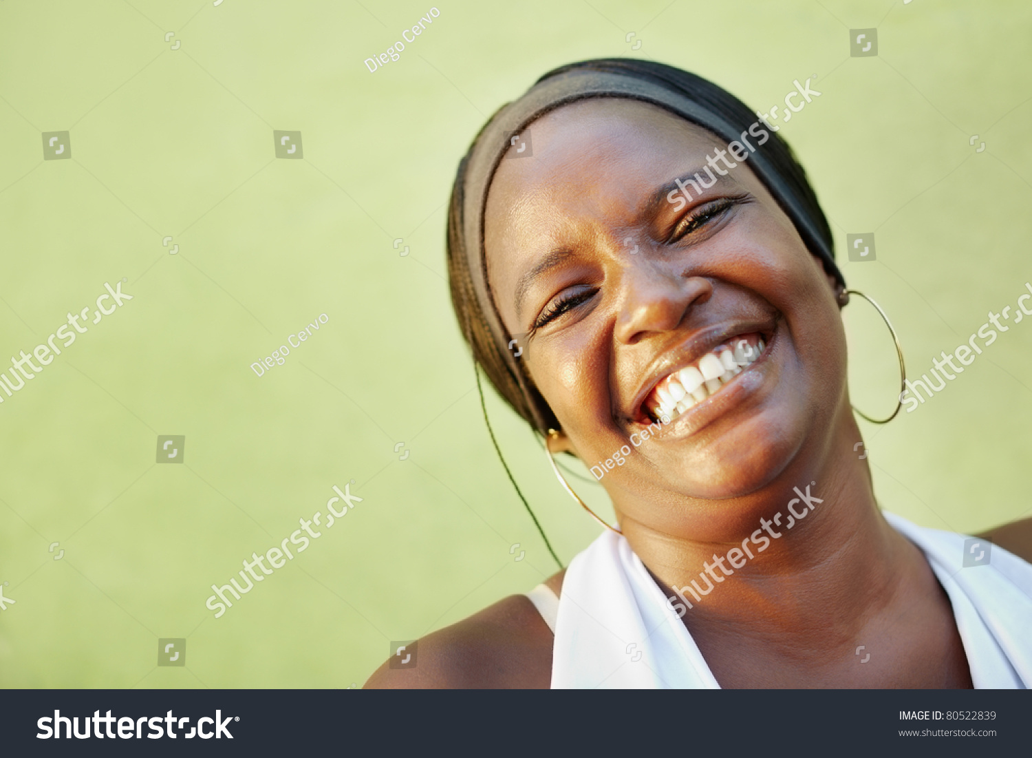 portrait of happy african adult woman looking at camera and smiling. Horizontal shape, copy space #80522839