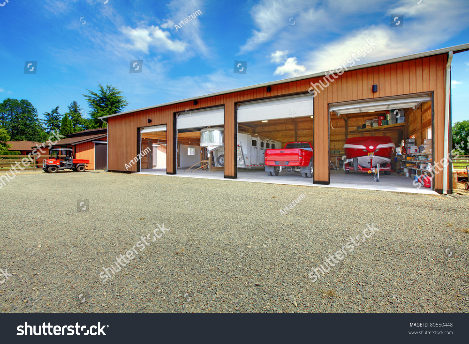Large ranch garage with car truck boat and trailer in for Boat garages