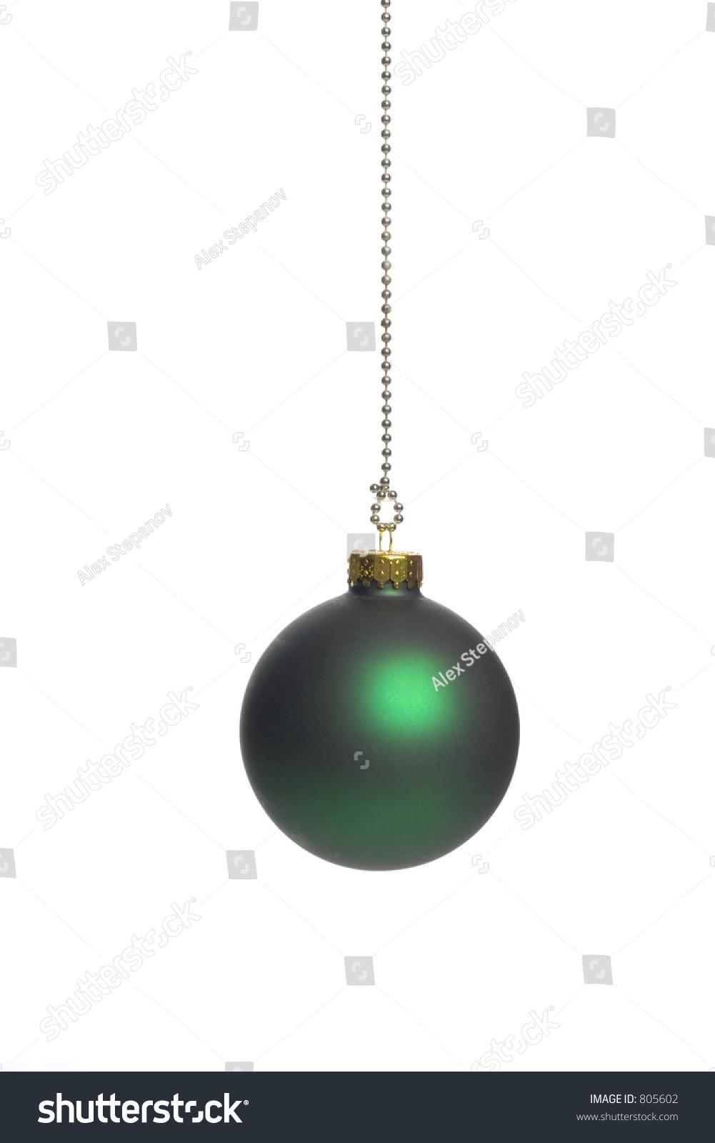 Vertical shot of a dark green christmas ball over white