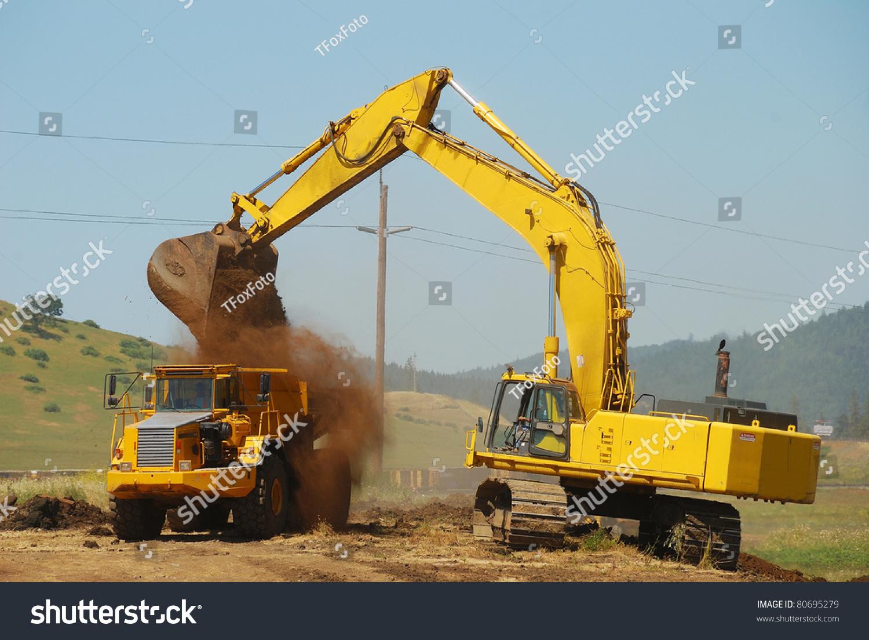 large excavator loading large dump truck stock photo 80695279