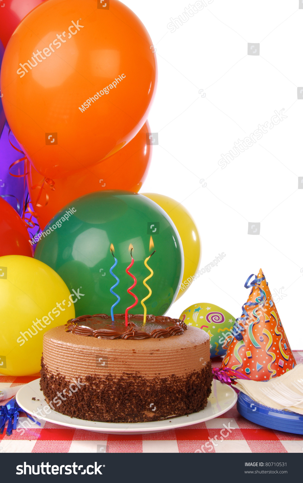 delicious chocolate birthday cake with candles and helium