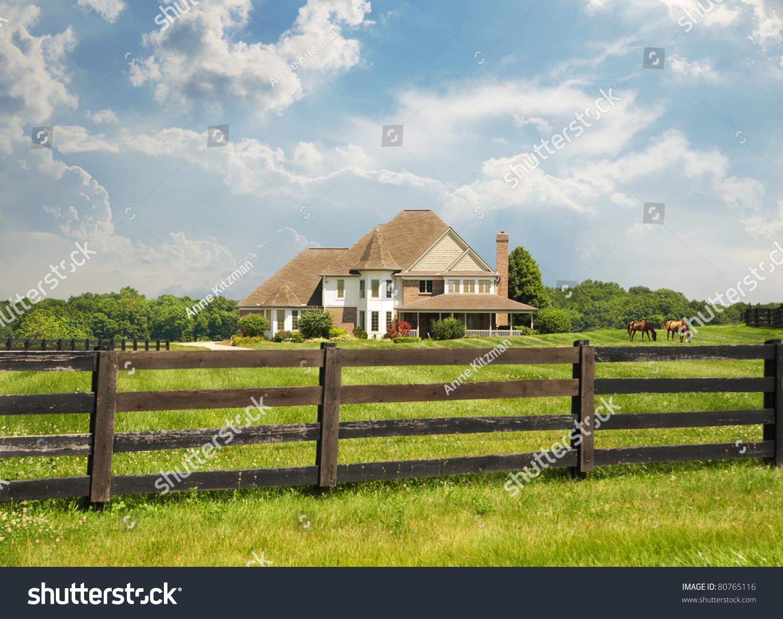 Sprawling Green Pastures Wood Fence Surround Stock Photo