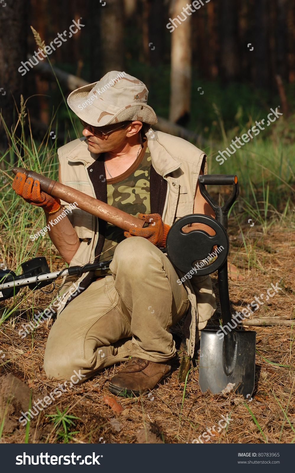 Jew Detector: Military Archeology. Man With Metal Detector And Soviet