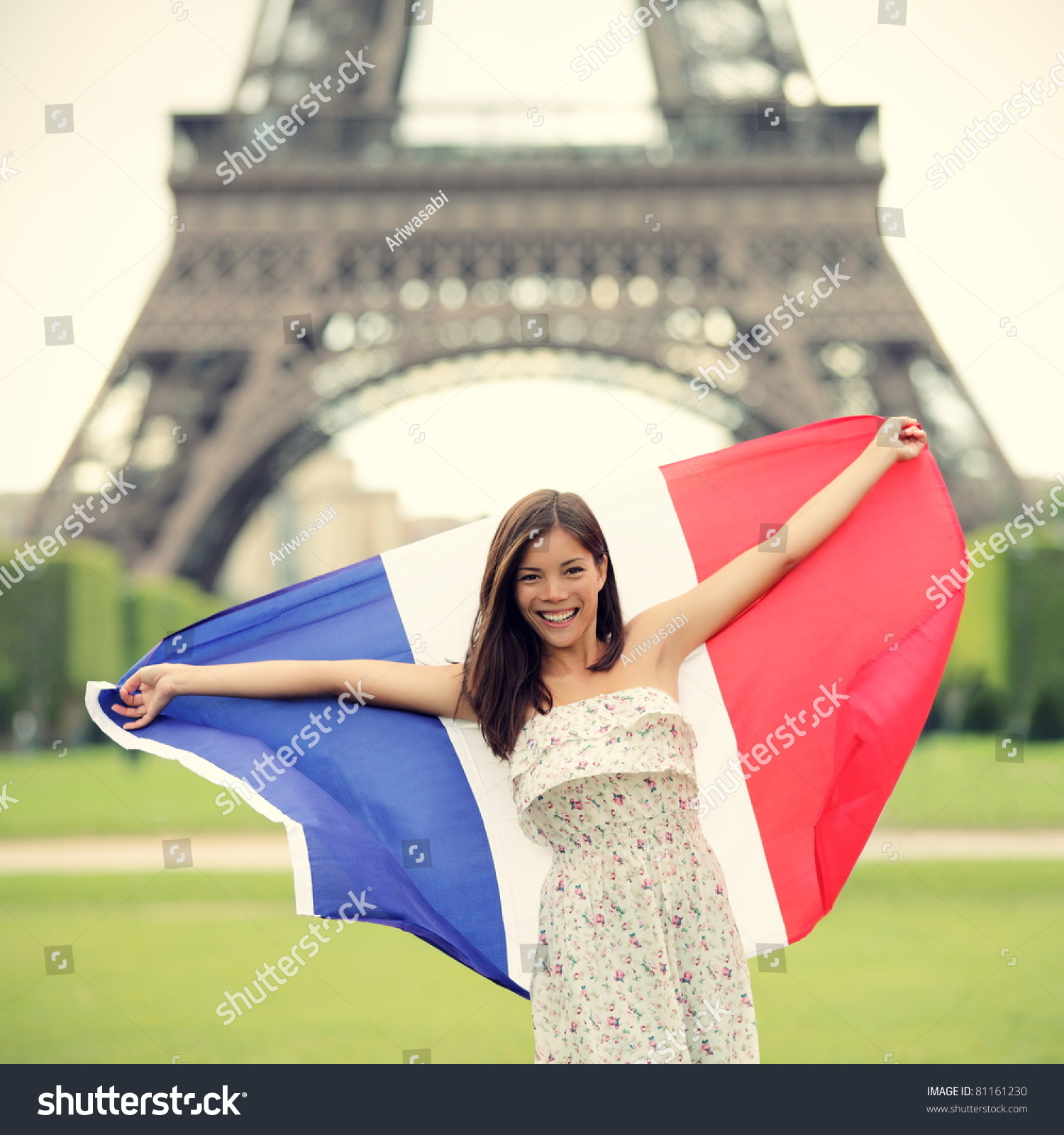 Paris Main Attractions In One Day: Paris Woman Holding French Flag By The Eiffel Tower In