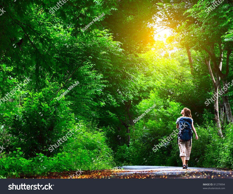 Photo Of Woman Walking On Road · Free Stock Photo