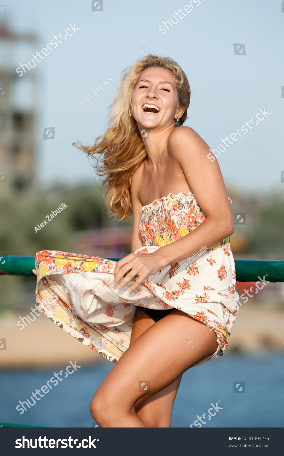 blonde holds her skirt blownstock photo (100% legal protection