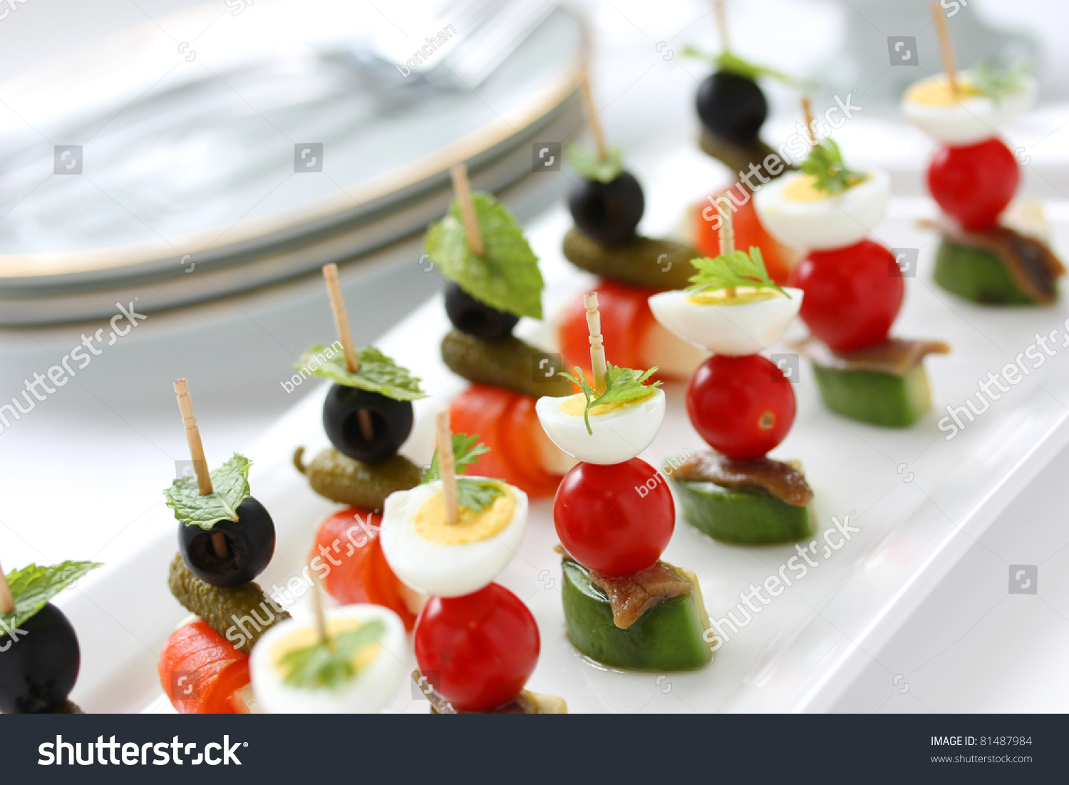 Canapes on toothpicks appetizer pinchos spanish stock for Appetizer canape