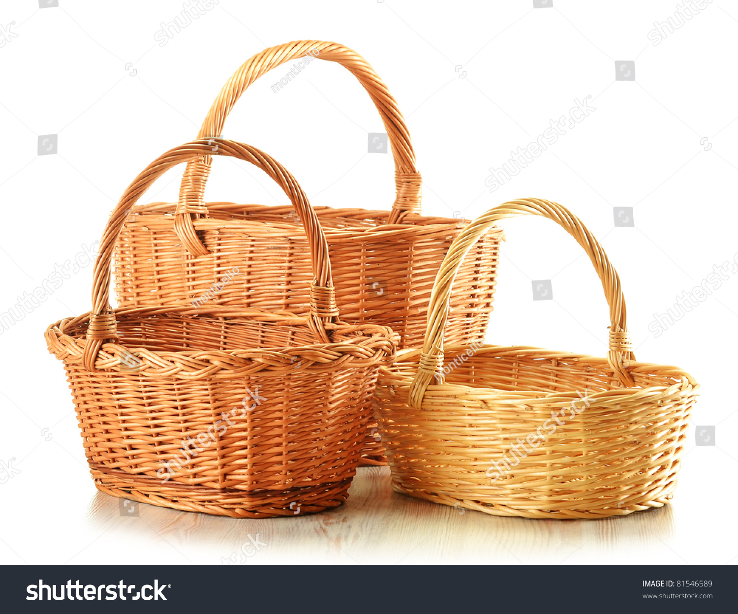 three empty wicker baskets isolated on white large medium and small