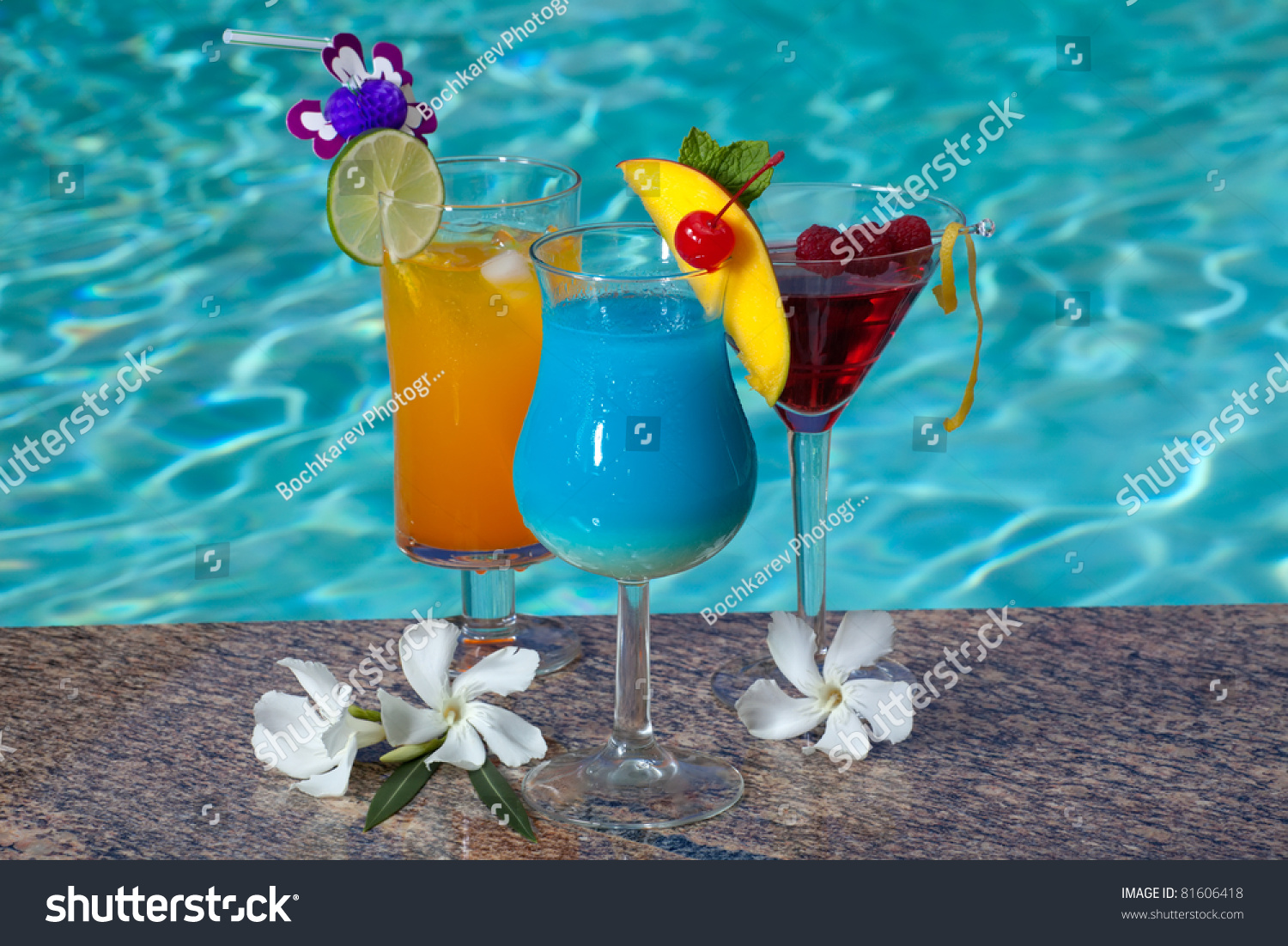 Mai Tai, Blue Hawaiian, and Cosmopolitan cocktails on swimming pool ...