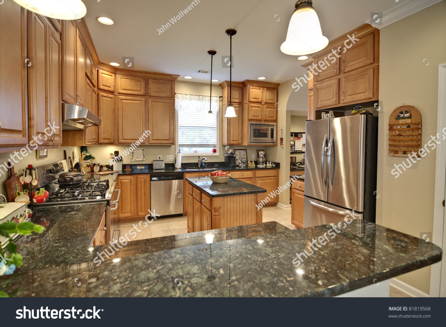 stock photo spacious modern kitchen with maple cabinets and granite 81819568