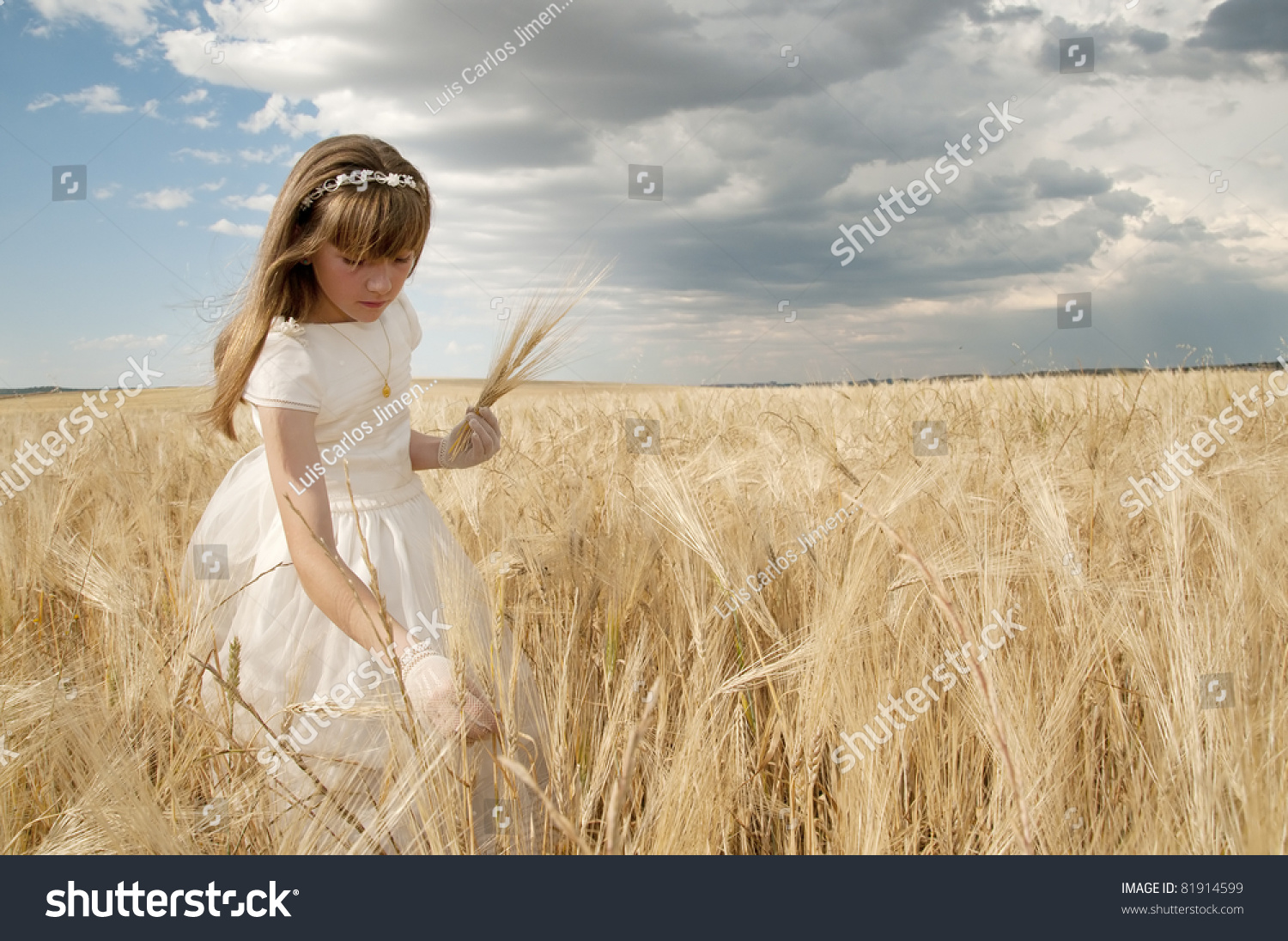 girl wearing first communion dress among the spikes