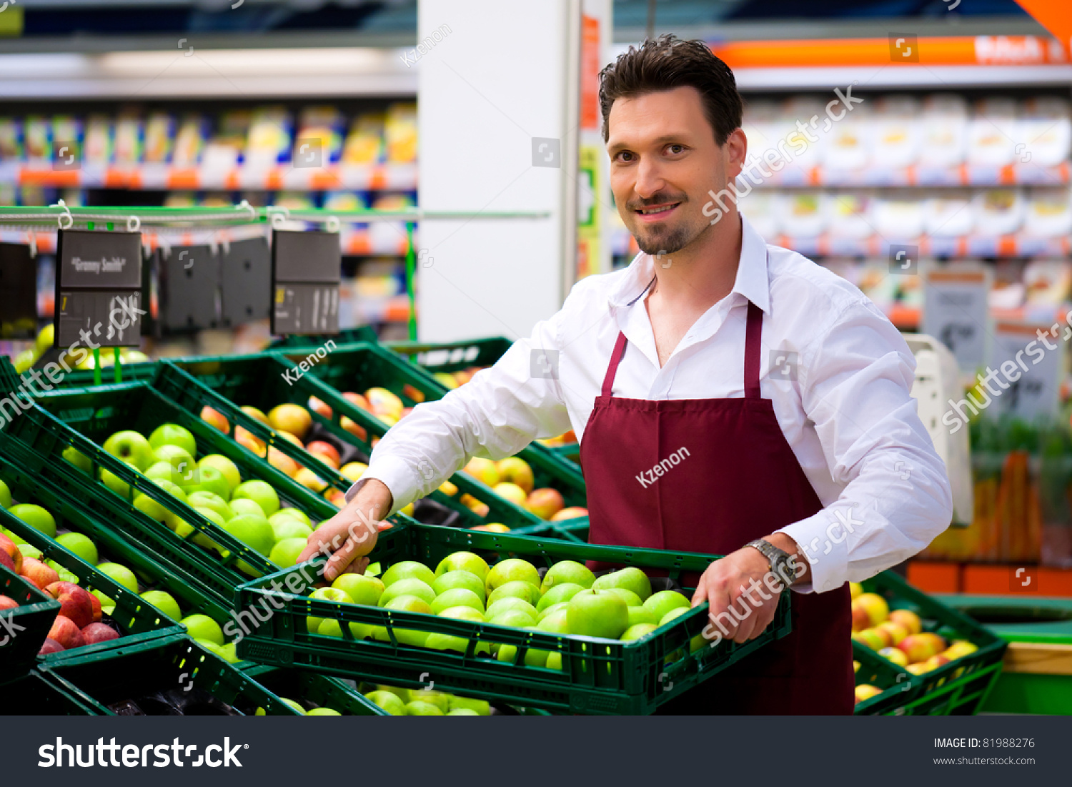 man supermarket shop assistant he brings stock photo  man in supermarket as shop assistant he brings some boxes apples