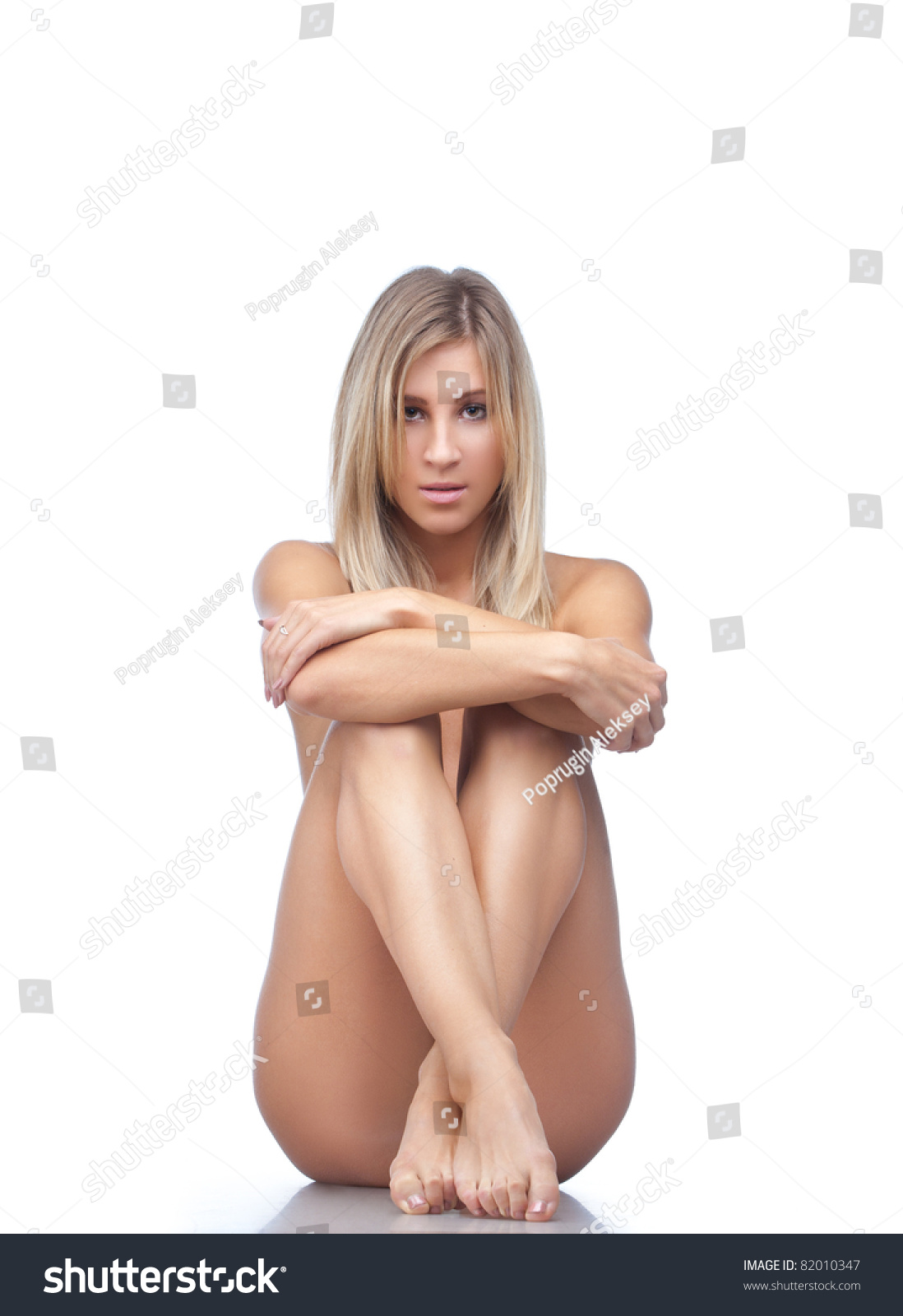 Beautiful Naked Blonde Woman Sitting On The Floor Isolated Over White