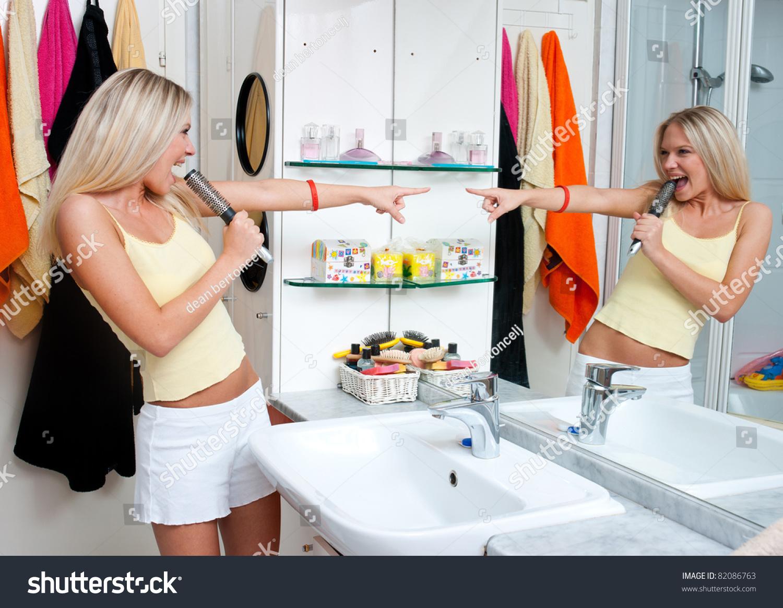 Attractive Teen Girl Singing Bathroom Stock Photo 82086763