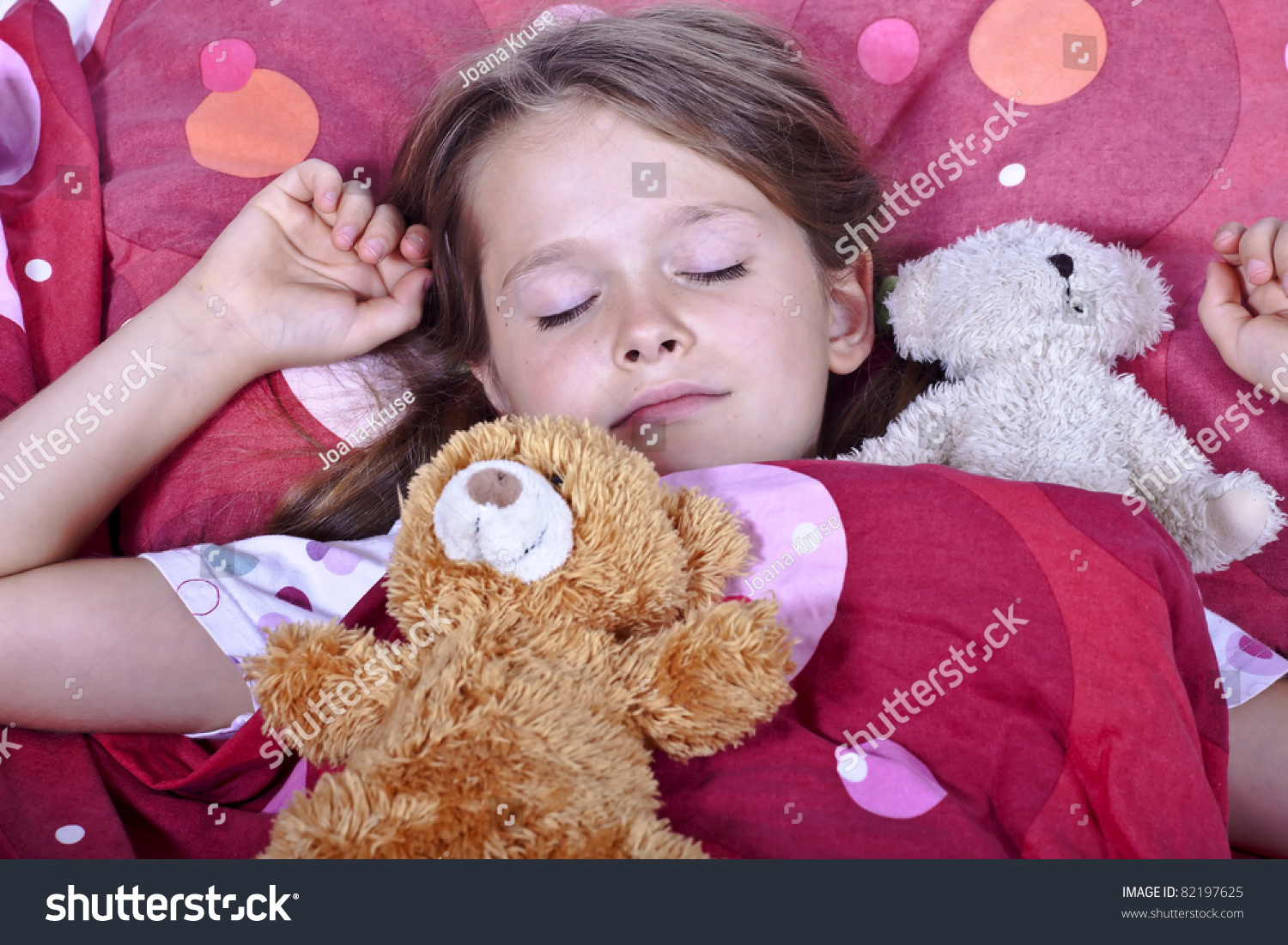 an eight year old girl in bed with blanket and pillows and stuffed animals stock photo 82197625. Black Bedroom Furniture Sets. Home Design Ideas