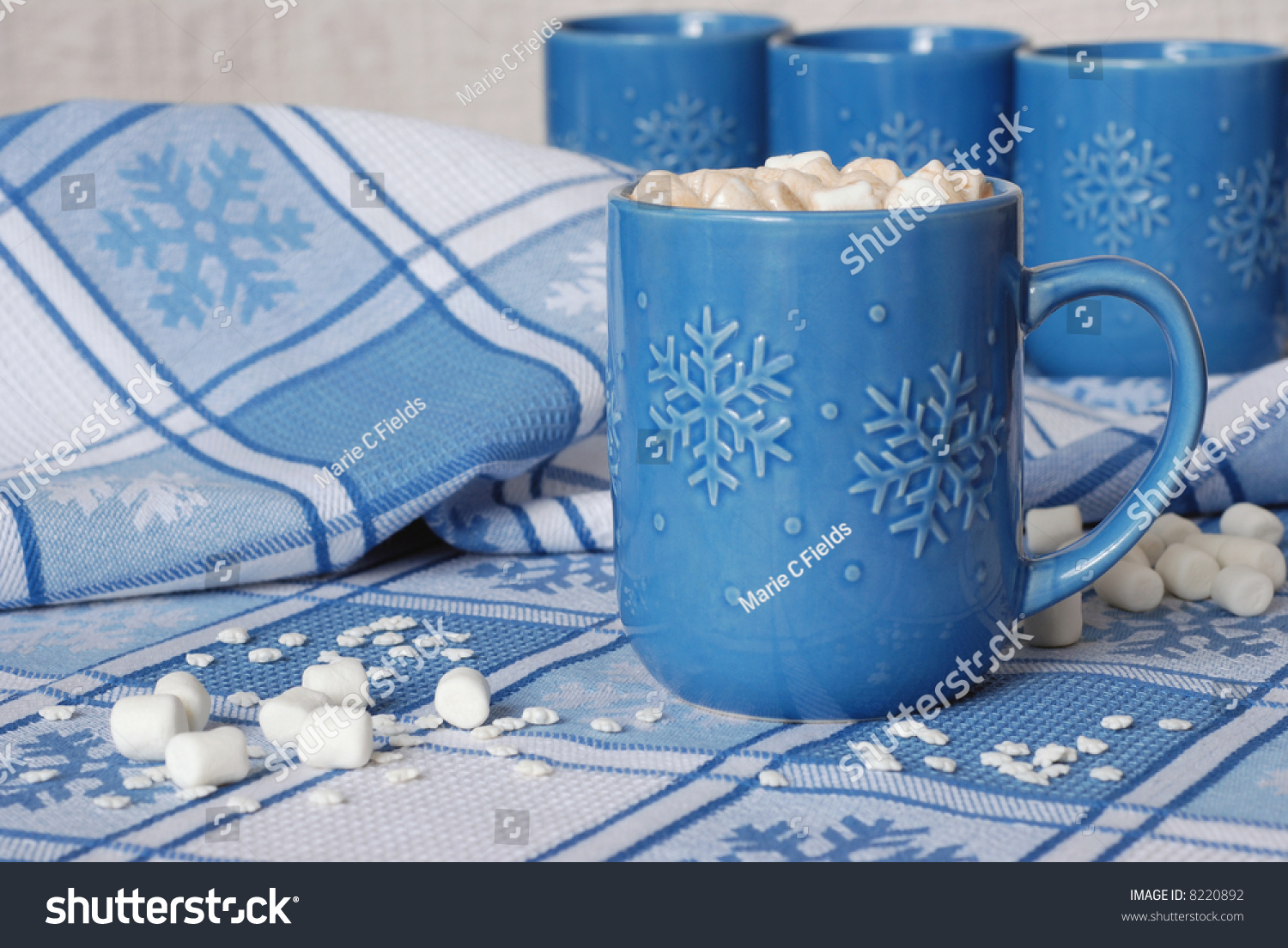 Good Blue Snowflake Mug Filled With Hot Chocolate And Marshmallows On Matching  Tablecloth. Miniature Marshmallows And