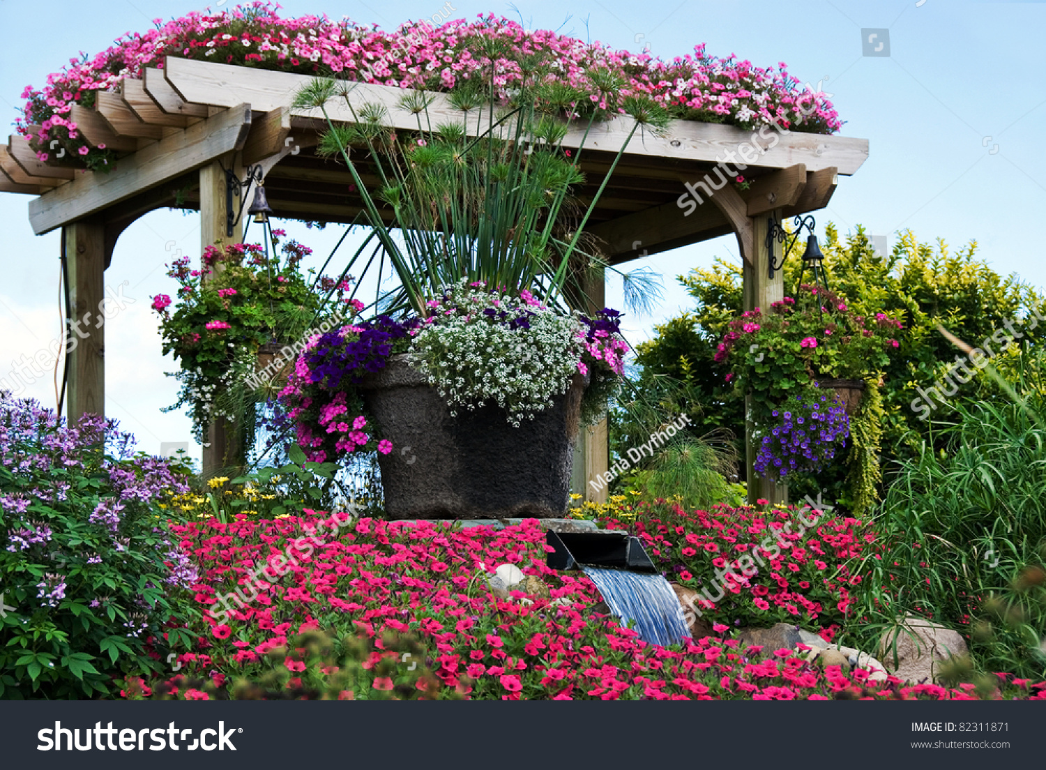 Waterfall Flowing Through Floral Garden Stock Photo 82311871