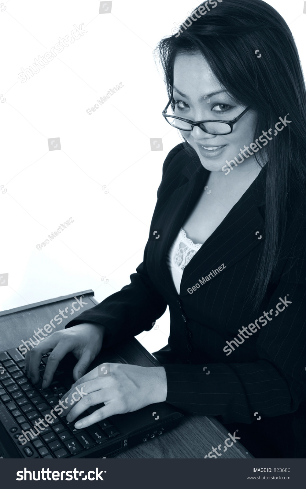 secretary typing on laptop in black and white over white background