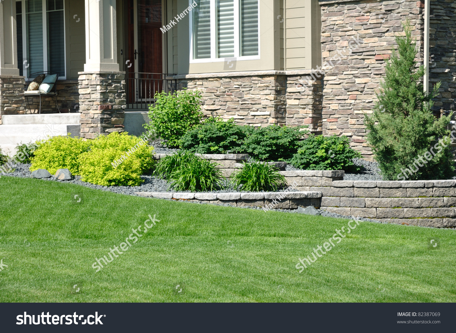 Residential House Landscaping : Landscaping retaining wall residential home stock photo