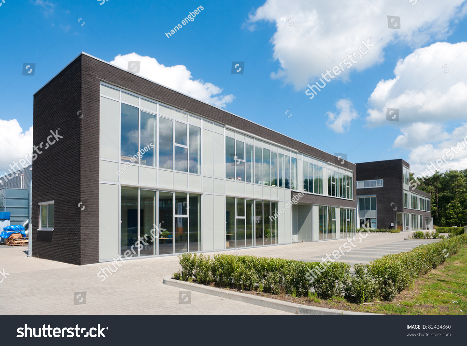 Small modern office building against nice stock photo for Modern small office building design